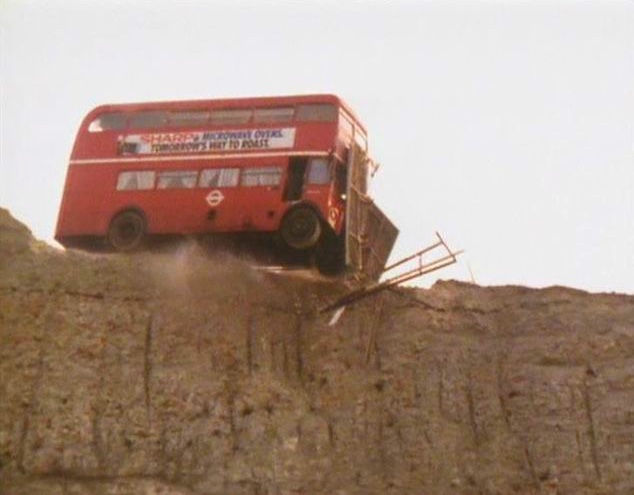 Bus from 'The Young Ones' going over a cliff
